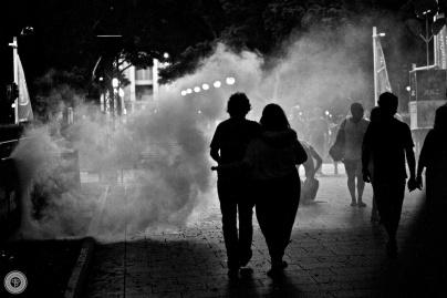 Couple walking through Hyde Park