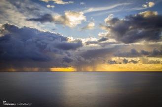 Sunrise rain showers rolling in